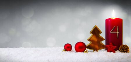 Fourth Advent.Christmas background with Advent candle and red decoration. Stok Fotoğraf