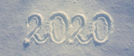 New years date 2020 written on snow. Winter background.