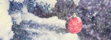 Christmas Ball hanging on a Fir Tree Branch. Christmas Background. Stock fotó - 133570491
