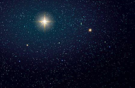 Christmas Star on dark abstract sky. Christmas background.