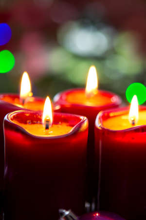 Four red candles for Advent. Christmas background.
