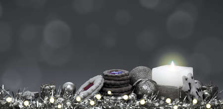 Advent candle with golden decoration and christmas cookies. Reklamní fotografie