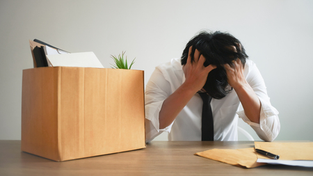 man stressing with resignation letter for quit a job. Banco de Imagens