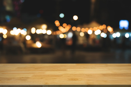 empty wood table with night street market background