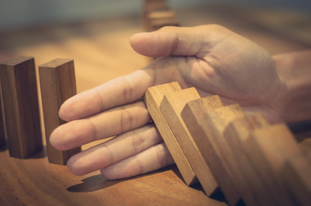 hands with wooden brick block, risk and solution concept. Фото со стока