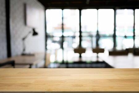 empty wood table desk in front of blurred coffee shop cafe background