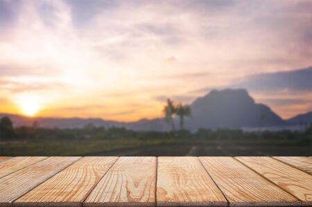 empty wood table in front of blurred montage wonderful mountain background Stockfoto
