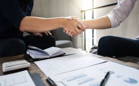 business executives partnership hand shaking