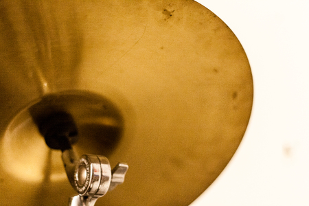 a portrait shoot from a drum set. old yellow drum cymbal looks very good. Stock Photo