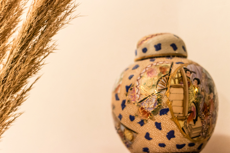 brown grass and chinese traditional vase. focus on the vase and looks very good. 스톡 콘텐츠
