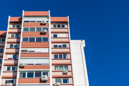 a rear view corner shoot of a tall building with blue background. photo has taken from izmir/turkey.