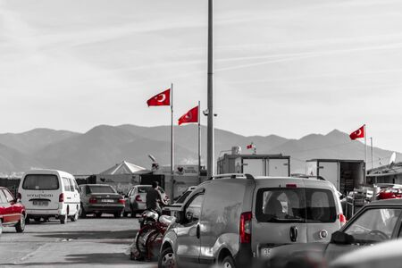 black and white shoot from a fisherman bay - turkish flags are red. photo has taken at izmirturkey.