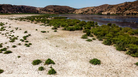 aerial drone shoot from side of an old lake - white sands and plain background. photo has taken at bafa lake at turkey.