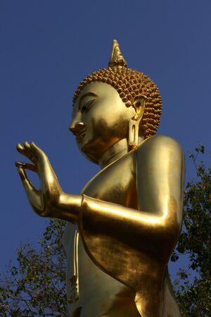 Gold Buddha :  Gold Buddha stand statue at Petburi Province in Thailand.