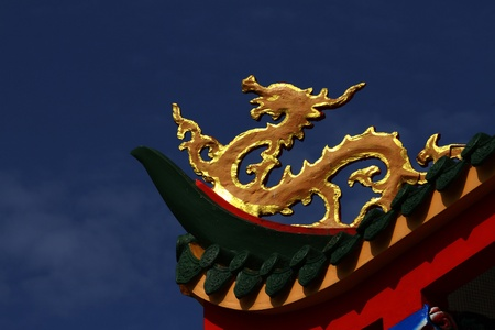 Chinese gold dragon :  Chinese gold dragon on blue sky background Stock Photo