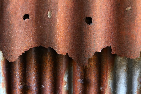 Rusty corrugatediron :  close-up of the rusty corrugatediron of and  old building at Chonburi Province in Thailand. photo