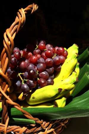 Mixed of Fruit : Close-up mixed of fruit on banana leaf in basket,Thailand Stock Photo