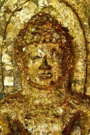 Gold leaf covered Buddha face