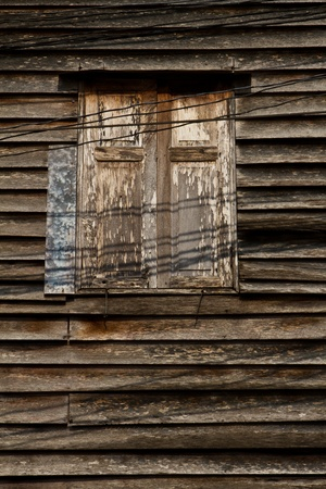 Old wooden window with the shadow of power lines