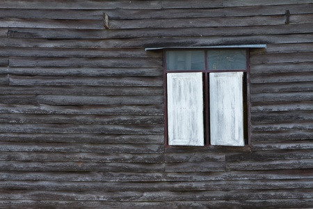 obsolescence: Old wooden wall with white window
