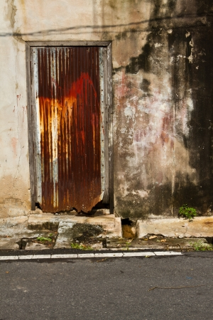 Stained plaster walls with colorful doors zinc Stock Photo