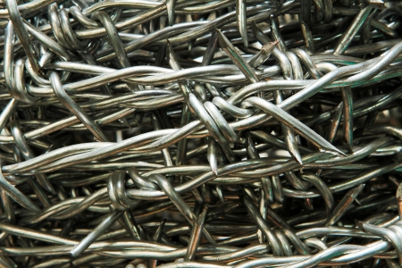 Sharp barbed wire silver background Stock Photo