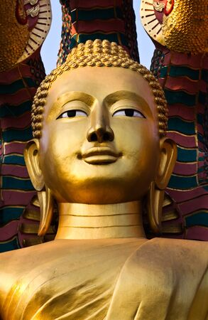 Gold face of Buddha,     Golden Buddha statues face the cement work of art created with  advance skills in the Buddhist faith to remain forever, Enshrined in Tak Province, Northern Thailand