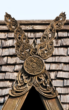 Carved wooden gables with roof background,  Wood carvings adorn the gables home Thai style northern provinces, Impressively detailed photo in Chiang Rai province, Thailand