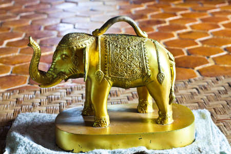 Brass Elephant duplicate,  Elephant model with cast brass engraving is used to predict the future based on the belief  that the church is the temple, Lamphun province, Northern Thailand  Stock Photo