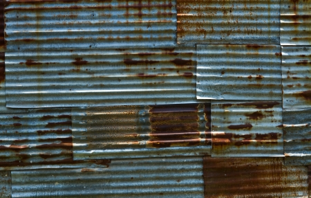 Rust zinc wall,  Rusty old corrugated iron walls of the disorder overlap in time with the sun causing shadows and depth that is beautiful, Chonburi province in Thailand  Stock Photo