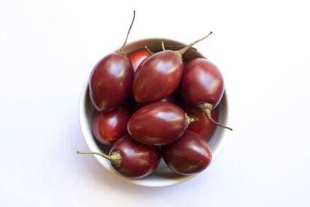 tamarillo: A bowl of juciy ripe red tamarillo fruit