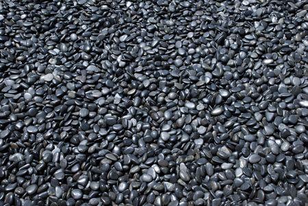black pebbles: dark grey pebbles Stock Photo
