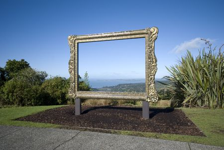 new zealand flax: The view over manakau harbour through a frame