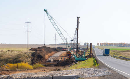 12.08.2020 Russia, Bashkortostan: Road works on the M-7 highway, piling machine