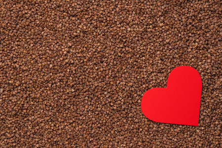 Red heart on the background of buckwheat