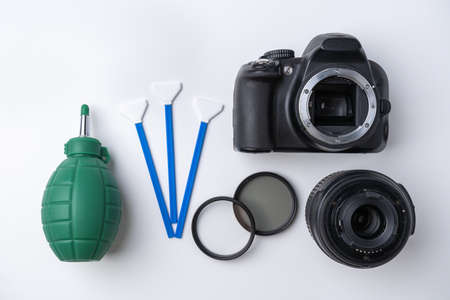 Tools for cleaning the sensor and lens of a DSLR camera