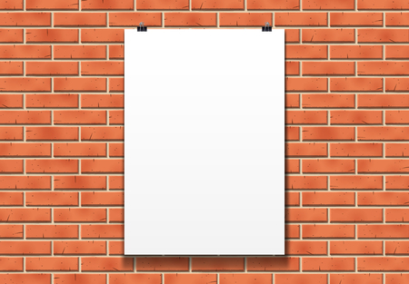 Blank poster mockup on the paper clips in front of red brick wall in bright loft room