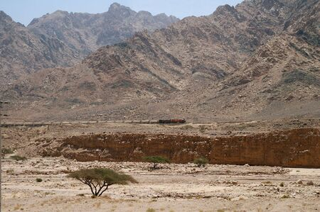 Old Jordan railway. Train in desert mountains 스톡 콘텐츠