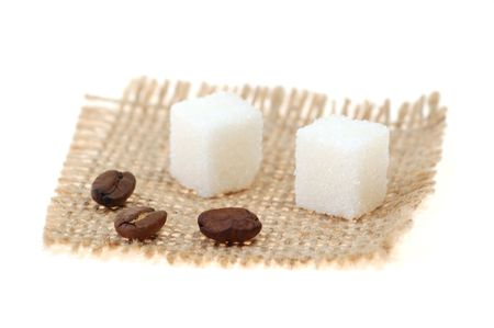vigor: Coffee beans and lump sugar on sackcloth Stock Photo