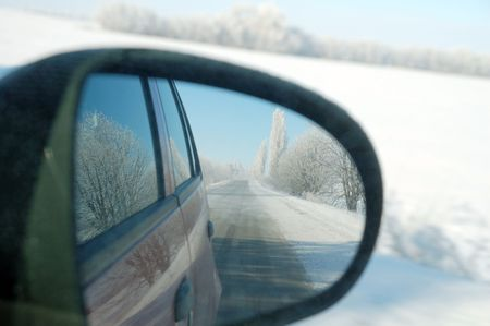 rearview: Road reflected in rear-view mirror