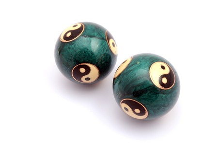 Green Chinese balls for relaxation on white background