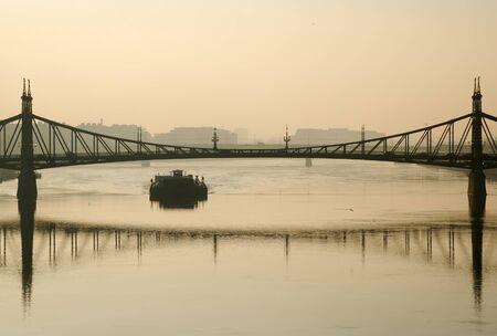 Budapest bridge and barge in morning haze 스톡 콘텐츠