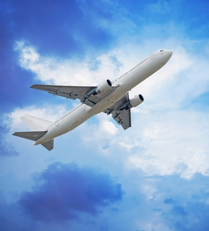 Passenger airliner in blue sky photo