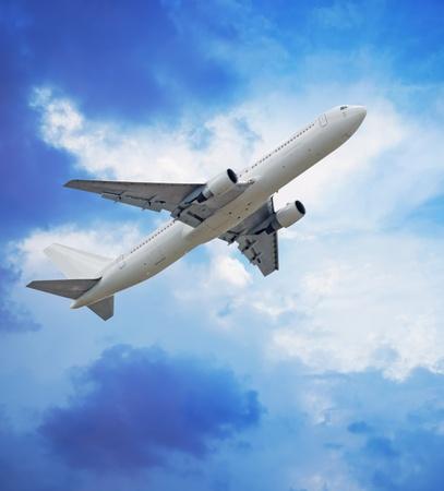 trave: Passenger airliner in blue sky