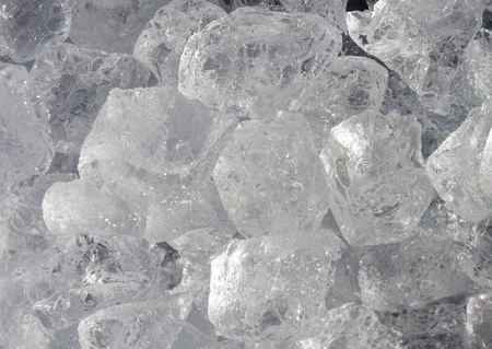 pile of ice-cubes creating background photo