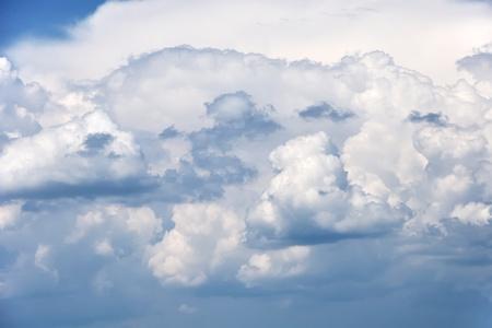 clr: fluffy clouds in blue sky