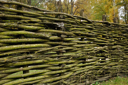 Traditional lath fence around a farmers house in Ukraine photo