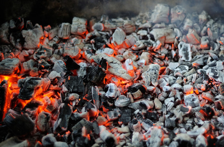 smoldering coals are ready for baking barbecue Фото со стока