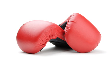 punching bag: red leather boxing gloves for punching bag or for karate on white background