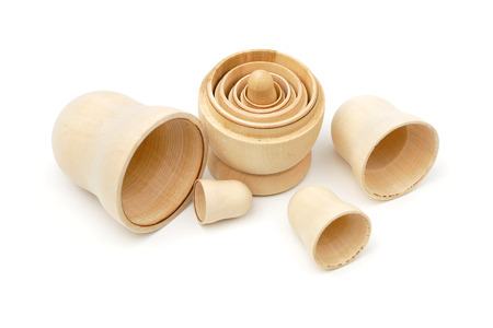 matreshka: Set of five disassembled wooden matryoshkas on white background